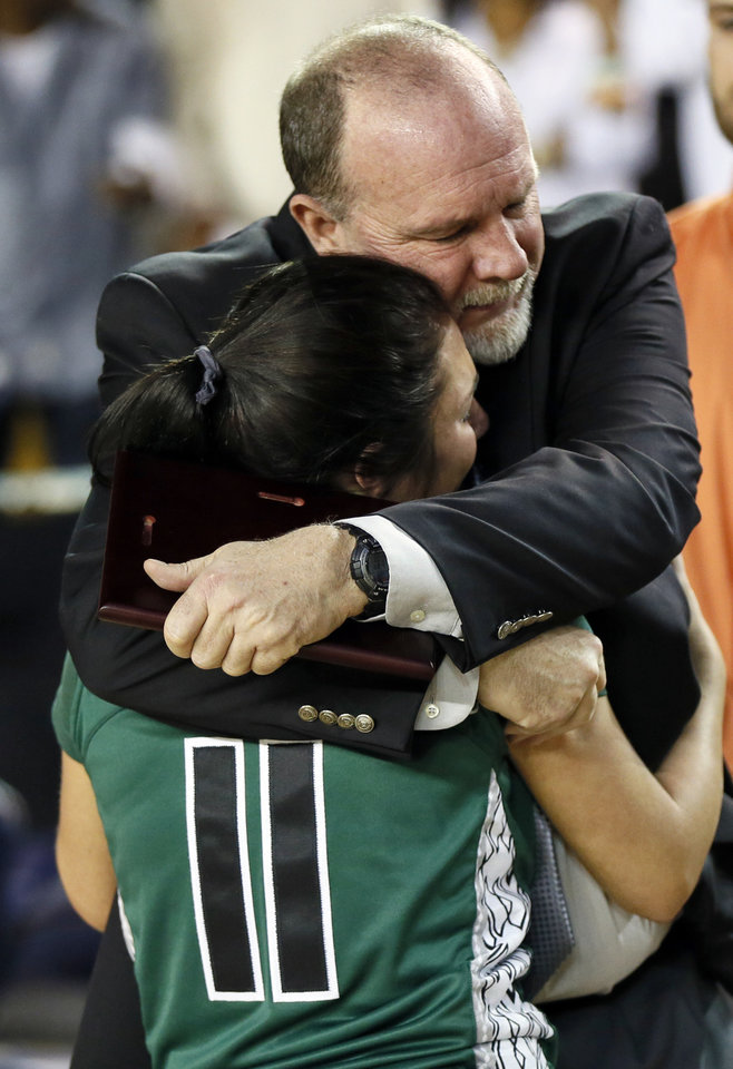 Photo - Edmond Santa Fe coach Paul Bass hugs Rachel Shadid (11) after the Class 6A girls championship game in the state high school basketball tournament between Broken Arrow and Edmond Santa Fe at the Mabee Center in Tulsa, Okla., Saturday, March 15, 2014. Broken Arrow won, 70-51. Photo by Nate Billings, The Oklahoman