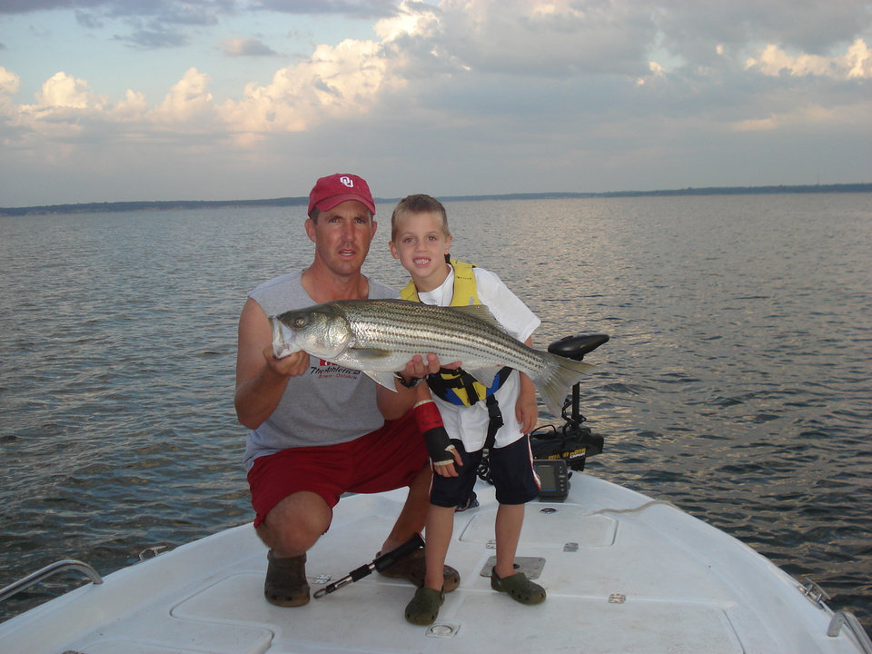 Photo -  Pat and Grant Proctor of Norman with a 10-pound striper caught Aug. 18 on Lake Texoma.
