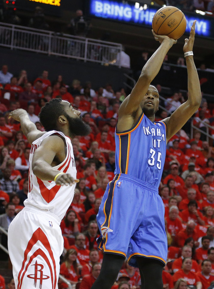 Oklahoma City's Kevin Durant (35) shoots the ball beside Houston's James Harden (13) during Game 6 in the first round of the NBA playoffs between the Oklahoma City Thunder and the Houston Rockets at the Toyota Center in Houston, Texas, Friday, May 3, 2013. Photo by Bryan Terry, The Oklahoman