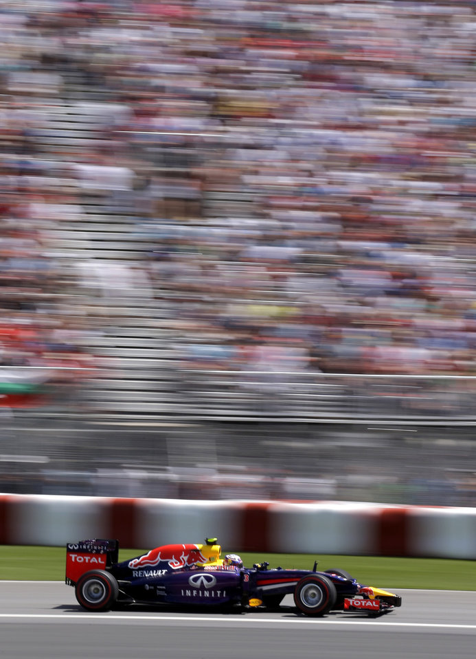 Photo - Red Bull driver Daniel Ricciardo, from Australia, drives through the course on his way to winning the  Canadian Grand Prix Sunday, June 8, 2014, in Montreal. (AP Photo/David J. Phillip)