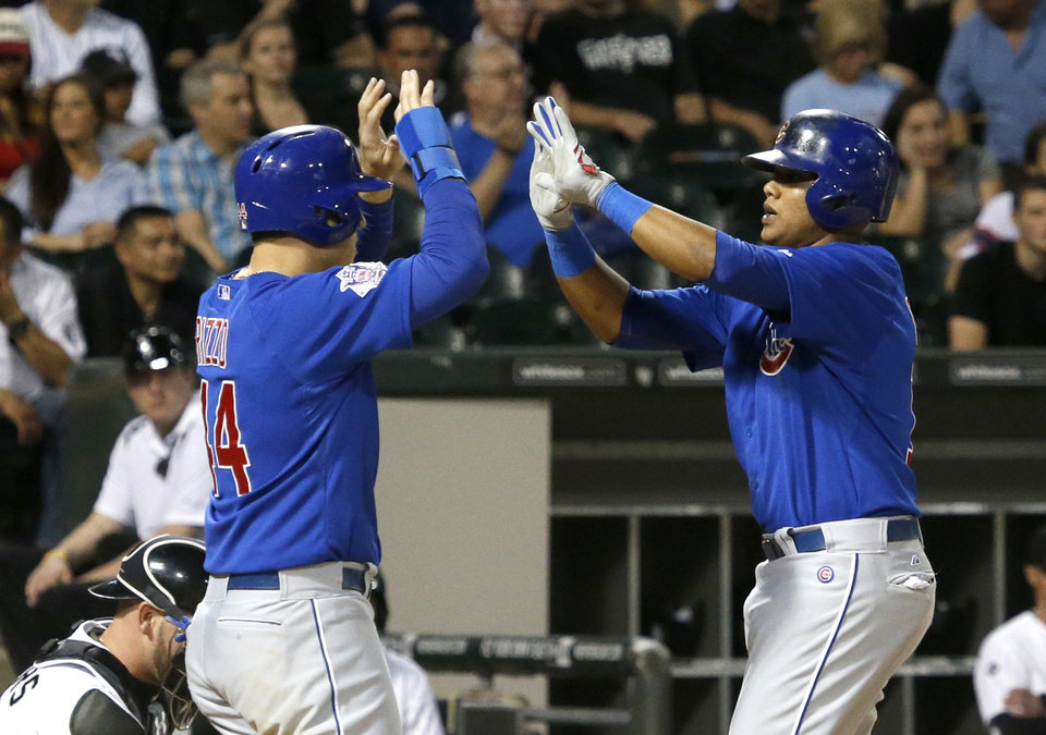 Photo - Chicago Cubs' Starlin Castro, right, celebrates his two-run home run with Anthony Rizzo, off Chicago White Sox starting pitcher Scott Carroll, during the fourth inning of an interleague baseball game Thursday, May 8, 2014, in Chicago. (AP Photo/Charles Rex Arbogast)
