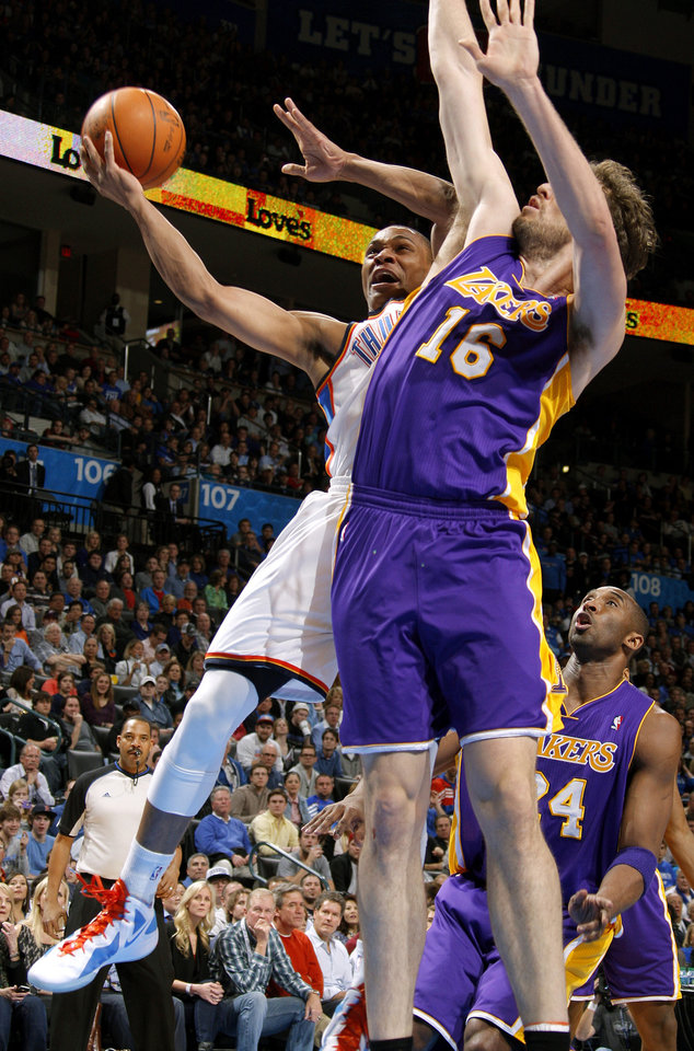Oklahoma City's Russell Westbrook (0) goes to the basket beside Los Angeles' Pau Gasol (16) during an NBA basketball game between the Oklahoma City Thunder and the Los Angeles Lakers at Chesapeake Energy Arena in Oklahoma City, Thursday, Feb. 23, 2012. Photo by Bryan Terry, The Oklahoman