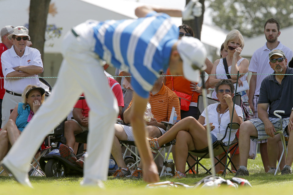 Photo - Fans watch as Steen Tinning gets ready to putt on the ninth green during the third round of the U.S. Senior Open golf tournament at Oak Tree National in Edmond, Okla., Saturday, July 12. Photo by Bryan Terry, The Oklahoman