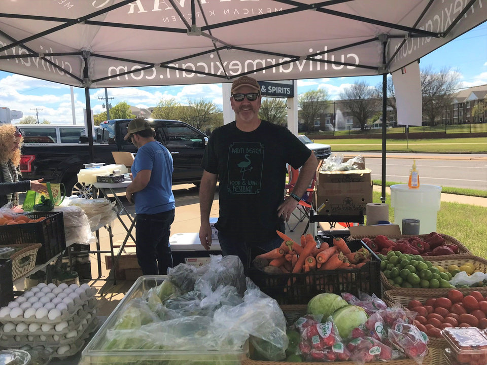 Photo - Gary Goldman of Cultivar Mexican Kitchen set up a street market at the corner of Pennsylvania Ave. and NW 150 St. in northwest Oklahoma City on Tuesday. [Dave Cathey/The Oklahoman]