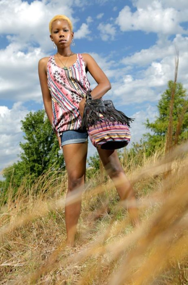 Photo -  FASHION / CLOTHES: Anna poses in Tribal print clothing near the Oklahoma River and the Chesapeake Boathouse in Oklahoma City on Wednesday, July 13, 2011. Photo by Ashley R. West, The Oklahoman ORG XMIT: KOD