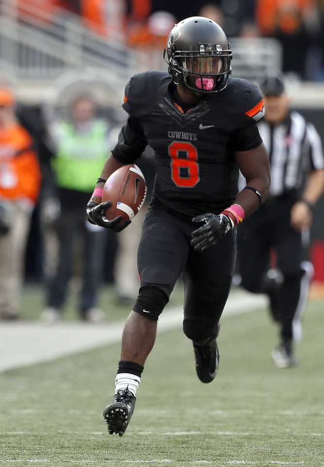 Photo - Oklahoma State's Daytawion Lowe (8) returns the ball after making an interception during a college football game between Oklahoma State University (OSU) and Texas Christian University (TCU) at Boone Pickens Stadium in Stillwater, Okla., Saturday, Oct. 27, 2012. Photo by Sarah Phipps, The Oklahoman