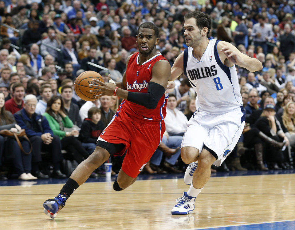 Los Angeles Clippers guard Chris Paul (3) controls the ball as Dallas Mavericks guard Jose Calderon (8) defends during the first half of an NBA basketball game Friday, Jan. 3, 2014, in Dallas. (AP Photo/Sharon Ellman)