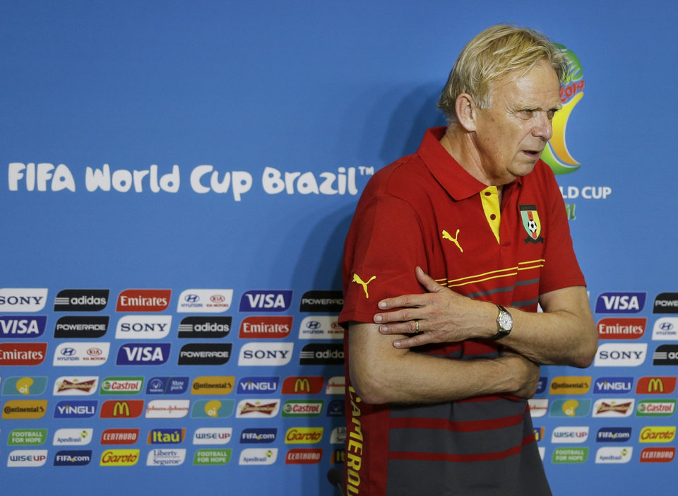 Photo - Cameroon coach Volker Finke flinches from the cold air of conditioner during a news conference at the Arena das Dunas in Natal, Brazil, Thursday, June 12, 2014. Cameroon will play in group A in the Brazil 2014 soccer World Cup. (AP Photo/Sergei Grits)