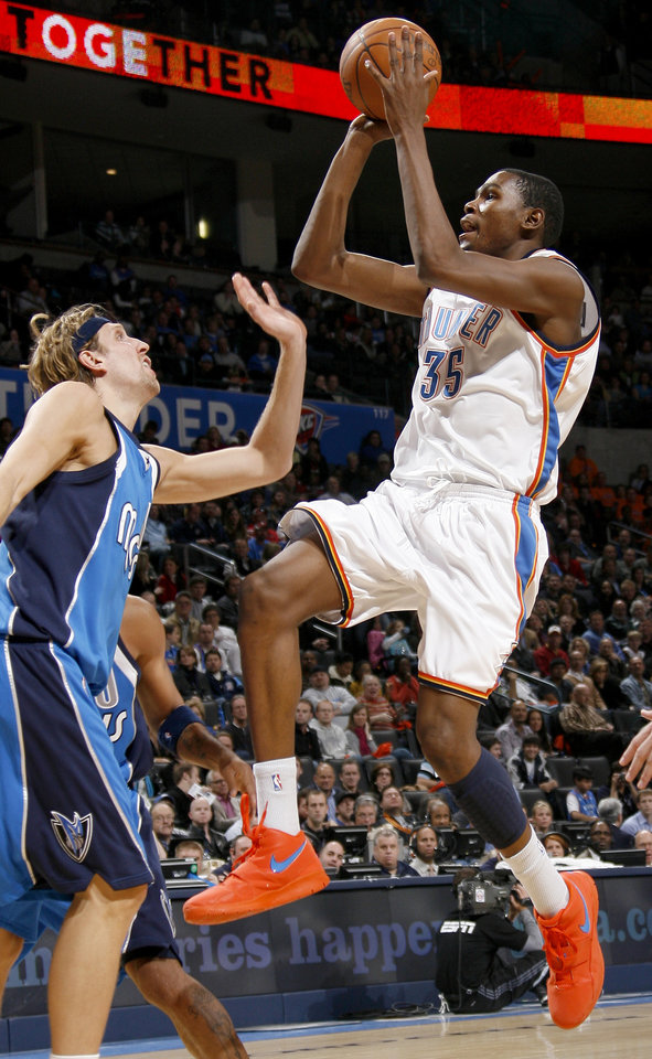 Photo - Oklahoma City's Kevin Durant tries to get past Dirk Nowitzki of Dallas during the NBA basketball game between the Oklahoma City Thunder and the Dallas Mavericks at the Ford Center in Oklahoma City on Wednesday, December 16, 2009. Photo by Bryan Terry, The Oklahoman