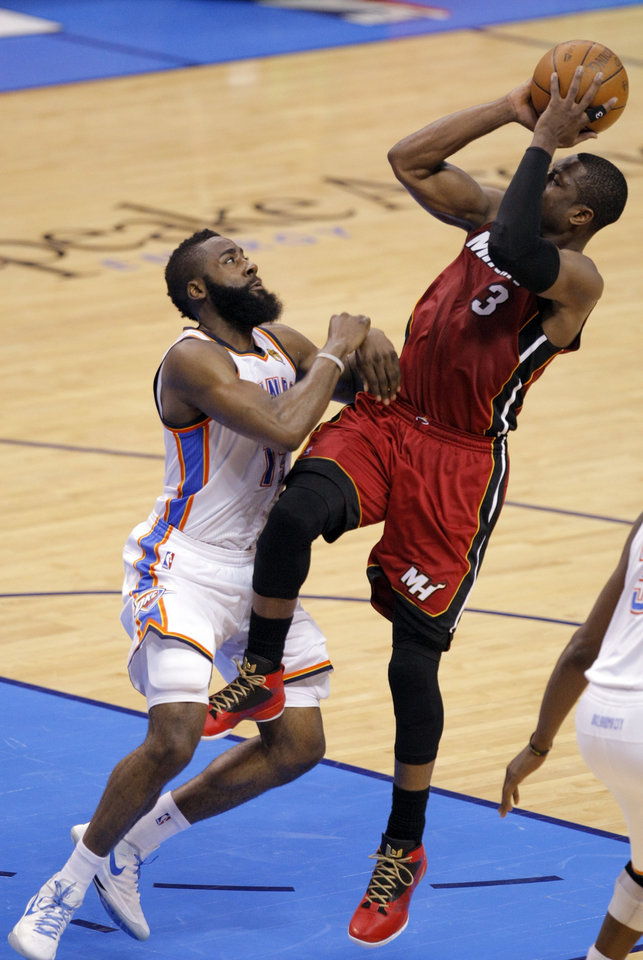 Oklahoma City\'s James Harden (13) defends against Miami\'s Dwyane Wade (3) during Game 1 of the NBA Finals between the Oklahoma City Thunder and the Miami Heat at Chesapeake Energy Arena in Oklahoma City, Tuesday, June 12, 2012. Photo by Sarah Phipps, The Oklahoman