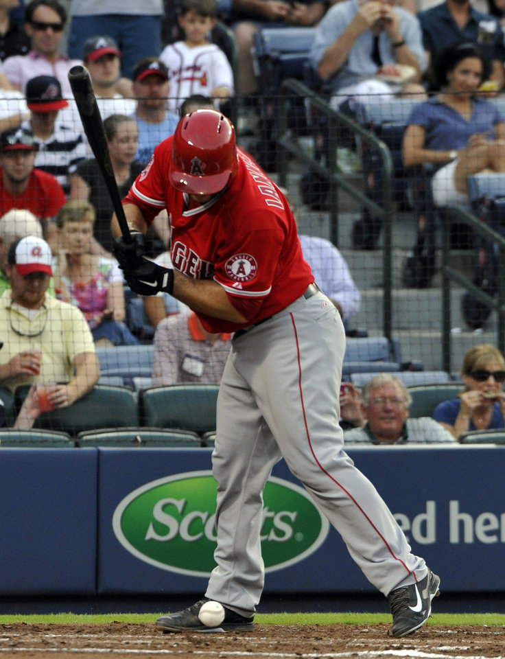 Photo - Los Angeles Angels' Chris Iannetta is hit by a pitch from Atlanta Braves starting pitcher Gavin Floyd during the third inning of a baseball game on Saturday, June 14, 2014, in Atlanta. (AP Photo/David Tulis)
