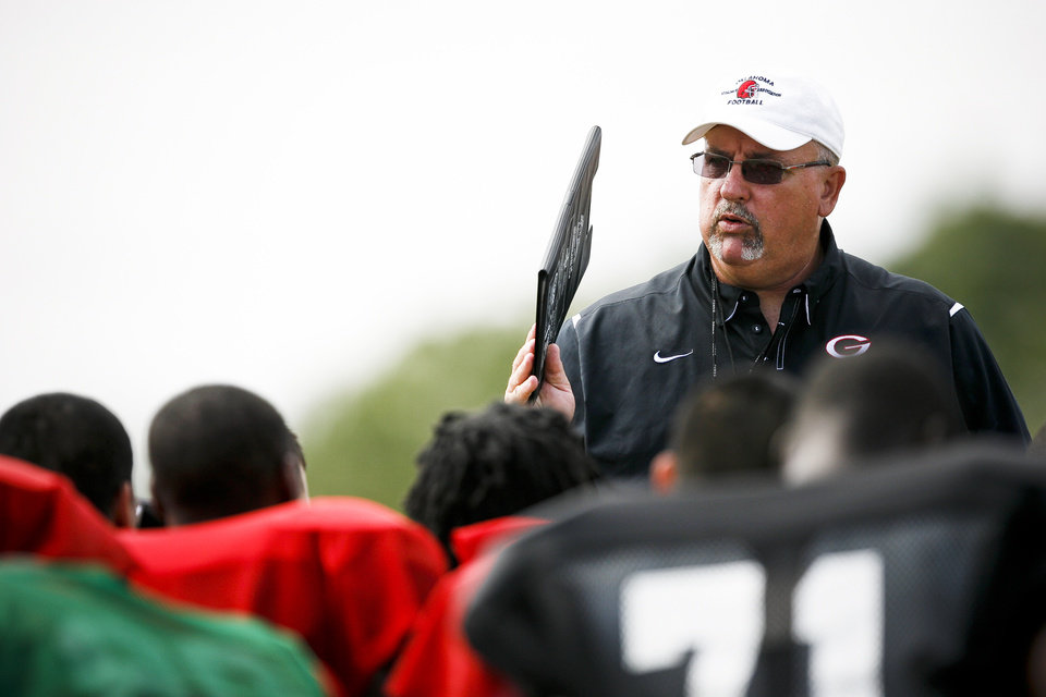 Photo - HIGH SCHOOL FOOTBALL: Generals coach Dan Burgess talks to his team after a scrimmage at U.S. Grant High School on Saturday, Aug. 13, 2011. Photo by Zach Gray, The Oklahoman ORG XMIT: KOD