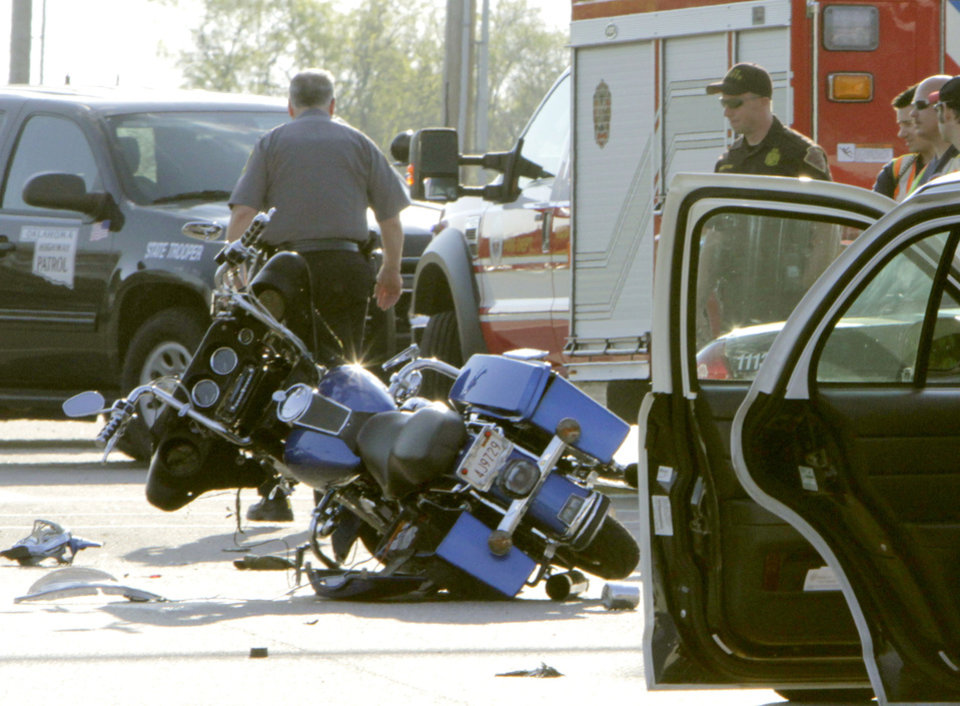 This fatality motorcycle auto accident occurred this morning at the Memorial Road entrance to Oklahoma Christian University in Oklahoma City, OK, Tuesday, March 27, 2012,  By Paul Hellstern, The Oklahoman