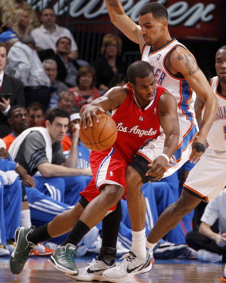 Los Angeles' Chris Paul (3) tries to get past Oklahoma City's Thabo Sefolosha (2) during the NBA basketball game between the Oklahoma City Thunder and the Los Angeles Clippers at Chesapeake Energy Arena in Oklahoma City, Wednesday, April 11, 2012. Photo by Bryan Terry, The Oklahoman
