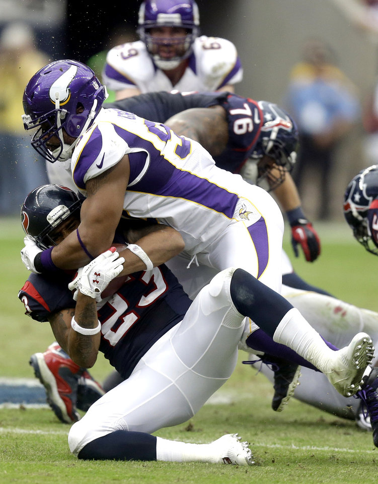 Houston Texans running back Arian Foster (23) is tackled by Minnesota Vikings' Everson Griffen during the first quarter of an NFL football game Sunday, Dec. 23, 2012, in Houston. (AP Photo/Patric Schneider)