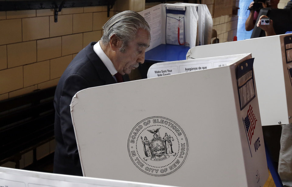 Photo - Congressman Charles Rangel, D-NY, marks his ballot as the votes in the congressional primaries, Tuesday, June 24, 2014, in New York. Rangel, 84, one of the most recognizable members of the Congressional Black Caucus, faces multiple challengers in his primary as he aims for a 23rd term representing demographically shifting areas of New York City. Rangel's top challenger is state Sen. Adriano Espaillat, who would become the first Dominican-born member of Congress. (AP Photo/Richard Drew)