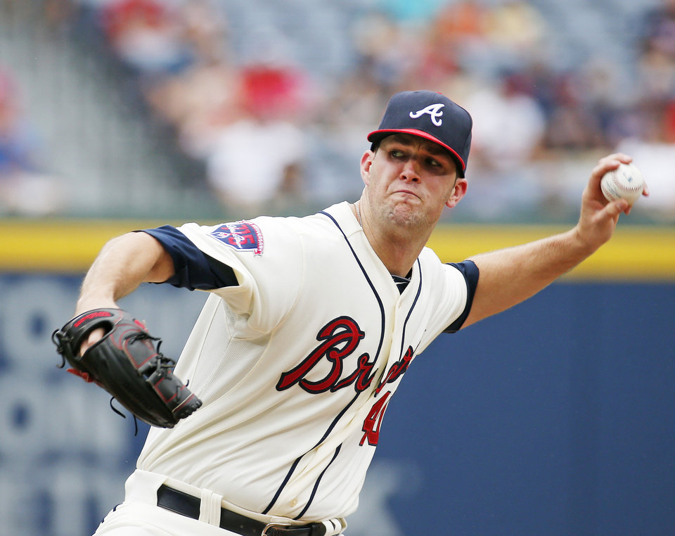 Photo - Atlanta Braves starting pitcher Alex Wood throws in the first inning of a baseball game against the Philadelphia Phillies in Atlanta, Sunday, July 20, 2014. Atlanta won 8-2. (AP Photo/John Bazemore)