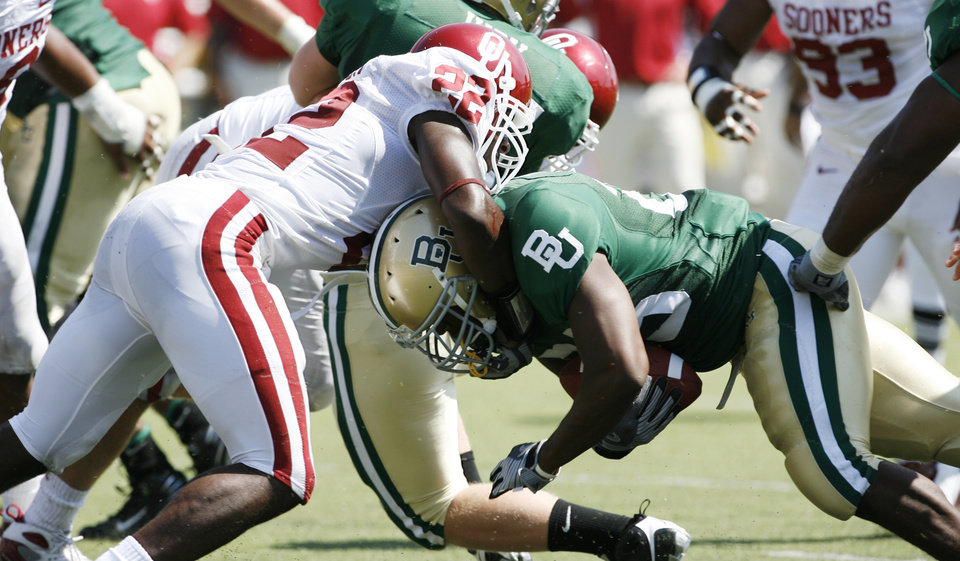 Photo - Keenan Clayton (22) stops Jacoby Jones in the first half during the college football game between Oklahoma (OU) and Baylor University at Floyd Casey Stadium in Waco, Texas, Saturday, October 4, 2008.   BY STEVE SISNEY, THE OKLAHOMAN