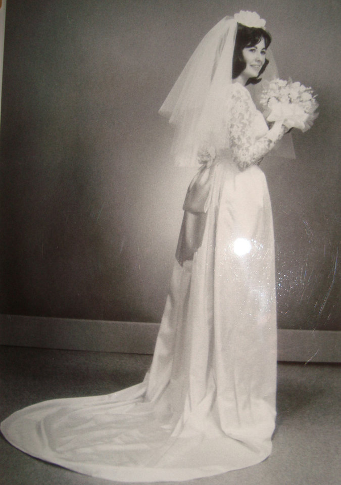Photo - Carol Ann Enlow-Cullum was a busy bride during the summer leading to her Aug. 30, 1963, wedding. Enlow-Cullum worked to create gowns for herself and  her bridesmaids. It came from a desire for her dress to be sleek and stylish while still traditional, said Renee Cullum, Carol's daughter. Her pillbox like veil was finished with help from her father. Photo provided by Renee Cullum.  PROVIDED