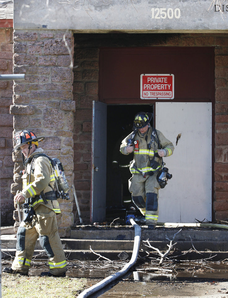 Oklahoma City firemen exit the main entrance after a fire at the vacant Dunjee School, 4300 Adair Street, in Oklahoma City Tuesday, Jan. 3, 2012.  Photo by Paul B. Southerland, The Oklahoman