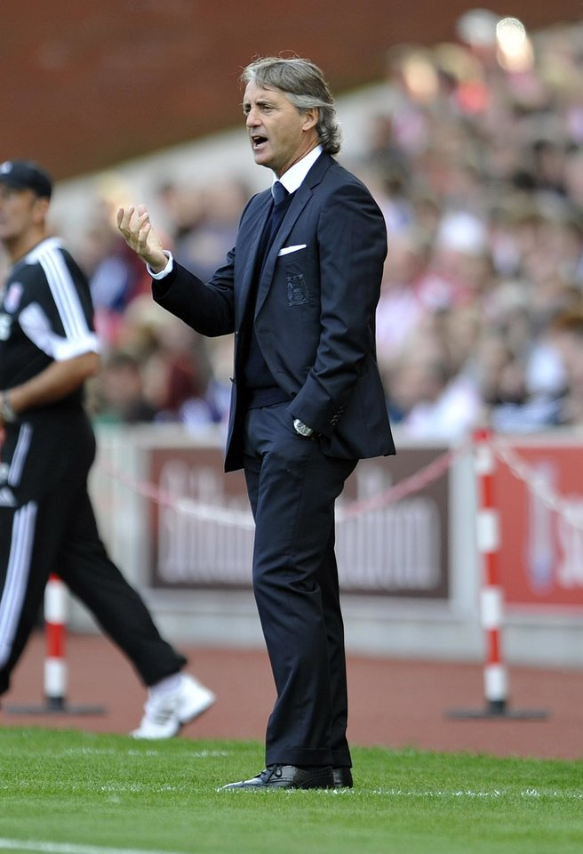 Photo -   Manchester City's manager Roberto Mancini gestures during their English Premier League soccer match against Stoke City at the Britannia Stadium in Stoke-on-Trent, England, Saturday Sept. 15, 2012. (AP Photo/Clint Hughes)