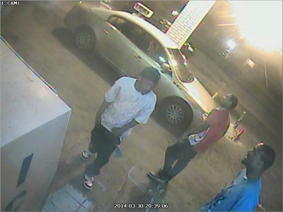 Photo -  Police released surveillance photos of three men wanted in connection with the fatal shooting Sunday of a pregnant woman in northeast Oklahoma City.