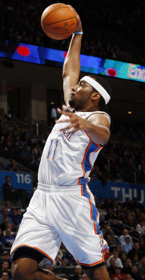 Photo - Oklahoma City's Lazar Hayward (11) dunks the ball in the fourth quarter during the NBA basketball game between the Oklahoma City Thunder and Phoenix Suns at Chesapeake Energy Arena in Oklahoma City, Saturday, Dec. 31, 2011. Oklahoma City won, 107-97. Photo by Nate Billings, The Oklahoman