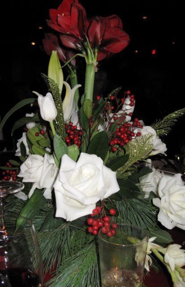 LOTUS CLUB DANCE....Holiday flower arrangements decorated the tables at the Oklahoma City Golf and Country Club for the Lotus Club dance.  (Photo by Helen Ford Wallace).