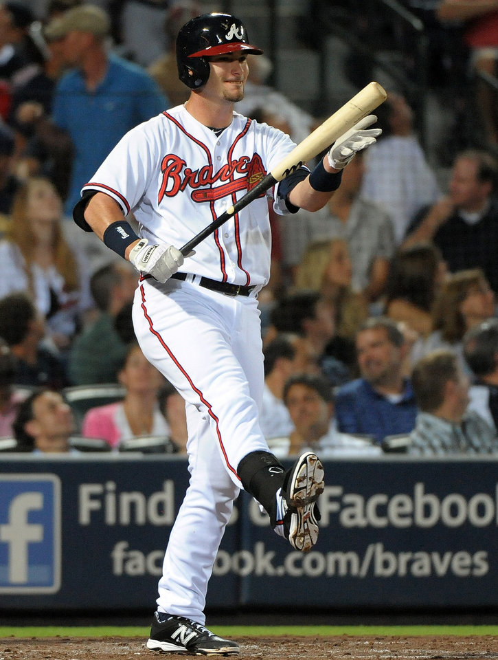 Photo - Atlanta Braves' Joey Terdoslavich reacts to a swinging at strike two during the fourth inning of a baseball game against the Cleveland Indians at Turner Field, Tuesday, Aug. 27, 2013, in Atlanta. (AP Photo/David Tulis)