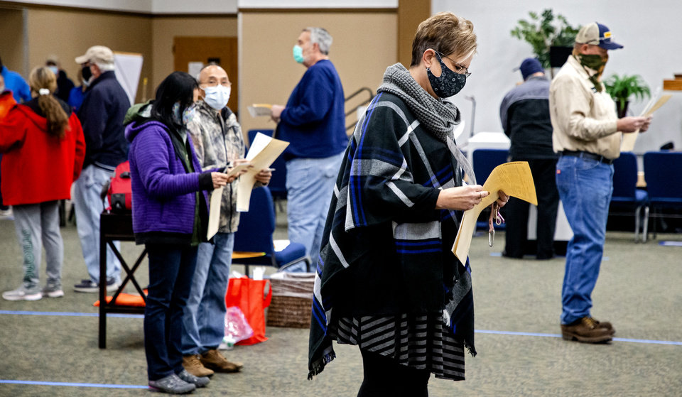 Photo - Voters wait in line to cast their ballots at the United Methodist Church of the Good Shepherd in Yukon, Okla. on Tuesday, Nov. 3, 2020. [Chris Landsberger/The Oklahoman]