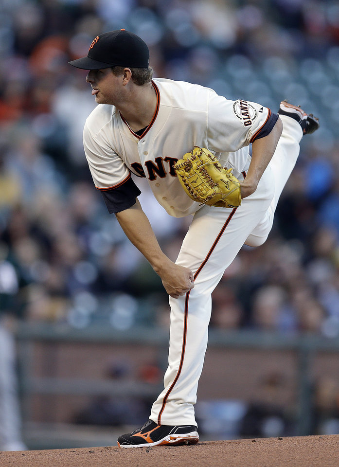 Photo - San Francisco Giants' Matt Cain works against the Oakland Athletics in the first inning of a baseball game Wednesday, July 9, 2014, in San Francisco. (AP Photo/Ben Margot)