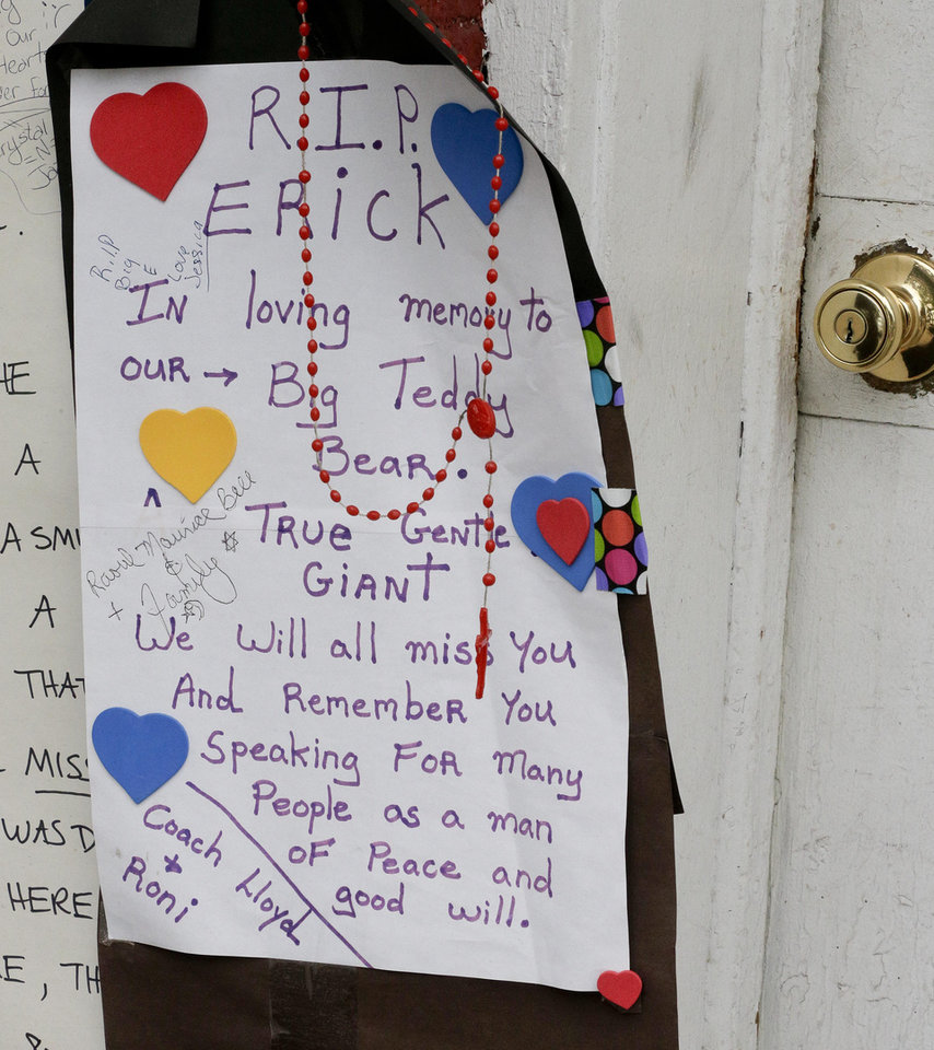 Photo - A hand made sign hangs at a makeshift memorial for Eric Garner, Friday, Aug. 1, 2014, in the Staten Island borough of New York. Garner died after he was put in a chokehold while being arrested last month for selling untaxed loose cigarettes. On Friday, the medical examiner ruled Garner's death to be a homicide caused by a police chokehold. (AP Photo/Julie Jacobson)