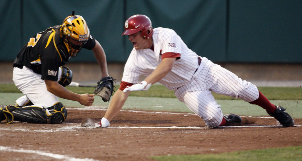 Photo - Aaron Baker scores the tying run as University of Oklahoma plays Wichita State at L. Dale Mitchell Park in the NCAA Regional baseball tournament in Norman, Okla. on Friday, May 29, 2009. 