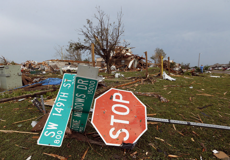 A street sign is knocked over in front of a destroyed home at SW 149th and Stone Meadows Dr. after a tornado struck south Oklahoma City and Moore, Okla., Monday, May 20, 2013. Photo by Nate Billings, The Oklahoman