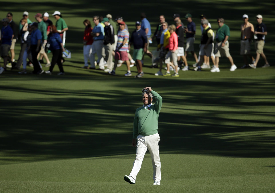 Photo - Fred Couples walks down the second fairway during the first round of the Masters golf tournament Thursday, April 10, 2014, in Augusta, Ga. (AP Photo/Chris Carlson)