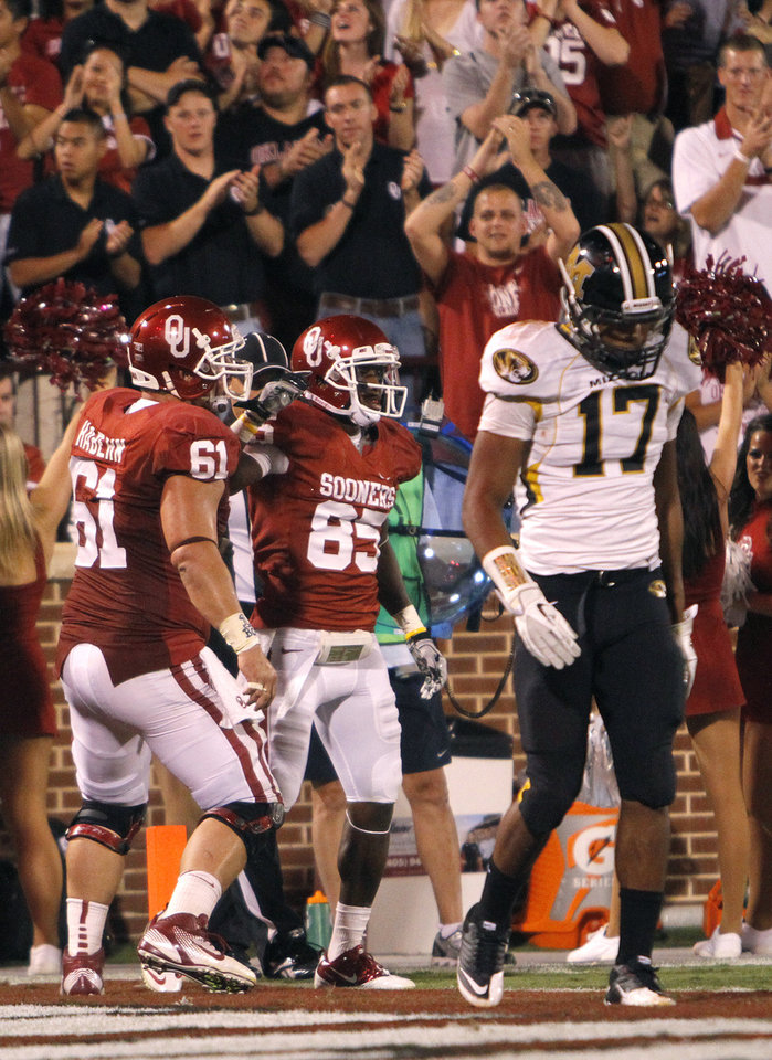 Photo - Missouri's Matt White (17) walks away as Oklahoma's Ryan Broyles (85) and Ben Habern (61) celebrate Broyles touchdown during their game on Saturday in Norman. Photo by Chris Landsberger, The Oklahoman