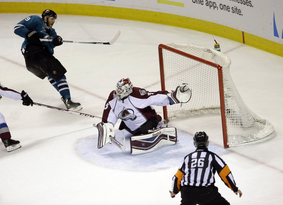 Photo - San Jose Sharks' Martin Havlat, top left, of the Czech Republic, scores his second goal of the game past Colorado Avalanche goalie Jean-Sebastien Giguere, during the third period of an NHL hockey game Friday, April 11, 2014, in San Jose, Calif. San Jose won 5-1. (AP Photo/Marcio Jose Sanchez)