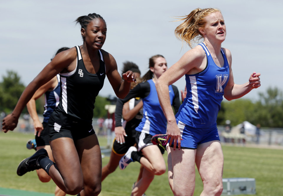 Vinita's Carsyn Spurgeon edges out Broken Bow's TieAnna Butler in the Girls 4A 100 Meter Dash during the State 3A and 4A Track Meet on Saturday, May 4, 2013, in Ardmore, Okla.   Photo by Steve Sisney, The Oklahoman