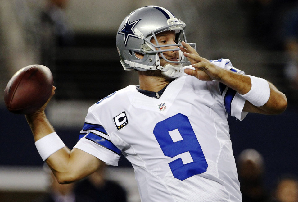 Dallas Cowboys quarterback Tony Romo (9) passes against the Philadelphia Eagles during the first half of an NFL football game, Sunday, Dec. 2, 2012, in Arlington, Texas. (AP Photo/Tony Gutierrez)
