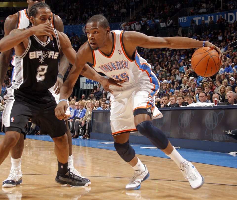 Oklahoma City Thunder's Kevin Durant (35) tries to get past San Antonio Spurs' Kawhi Leonard (2) during the the NBA basketball game between the Oklahoma City Thunder and the San Antonio Spurs at the Chesapeake Energy Arena in Oklahoma City, Sunday, Jan. 8, 2012. Photo by Sarah Phipps, The Oklahoman