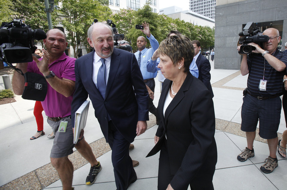 Photo - Jerri Fulkerson, right, Jonnie Williams's assistant, and her attorney George Terwilliger leave federal court after completing her testimony in the corruption trial of former Virginia Gov. Bob McDonnell and his wife Maureen, Wednesday, July 30, 2014 in Richmond, Va. (AP Photo/Richmond Times-Dispatch, James H. Wallace)