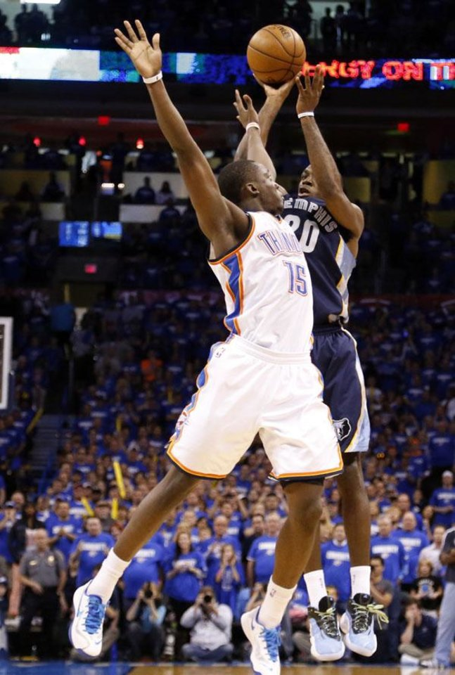 Oklahoma City's Reggie Jackson (15) fouls Memphis' Quincy Pondexter (20) on a three-point shot in the final seconds of Game 1 in the second round of the NBA playoffs between the Oklahoma City Thunder and the Memphis Grizzlies at Chesapeake Energy Arena in Oklahoma City, Sunday, May 5, 2013. Photo by Sarah Phipps, The Oklahoman