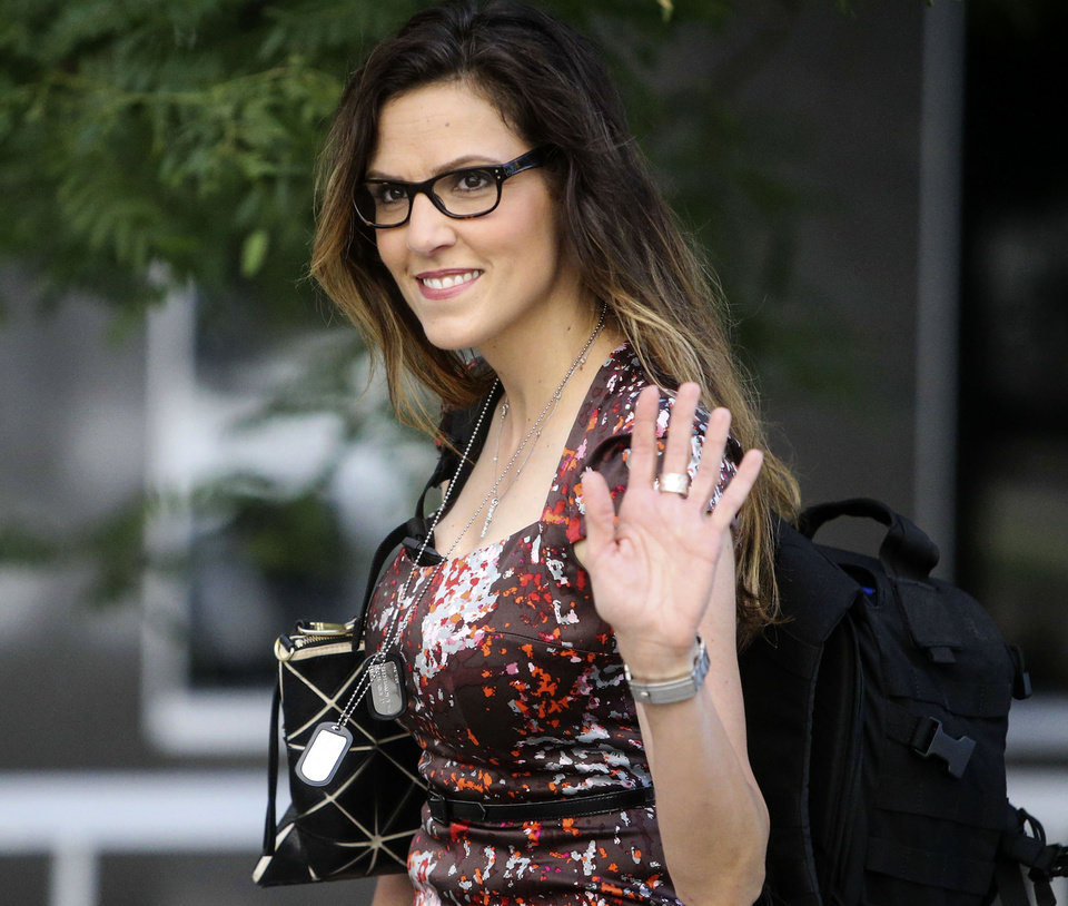 Photo - FILE - In this July 23, 2014, file photo, Taya Kyle, the widow of Navy SEAL Chris Kyle, arrives at U.S. District Court wearing dog tags around her neck in St. Paul, Minn. Jurors in former Minnesota Gov. Jesse Ventura's defamation lawsuit against