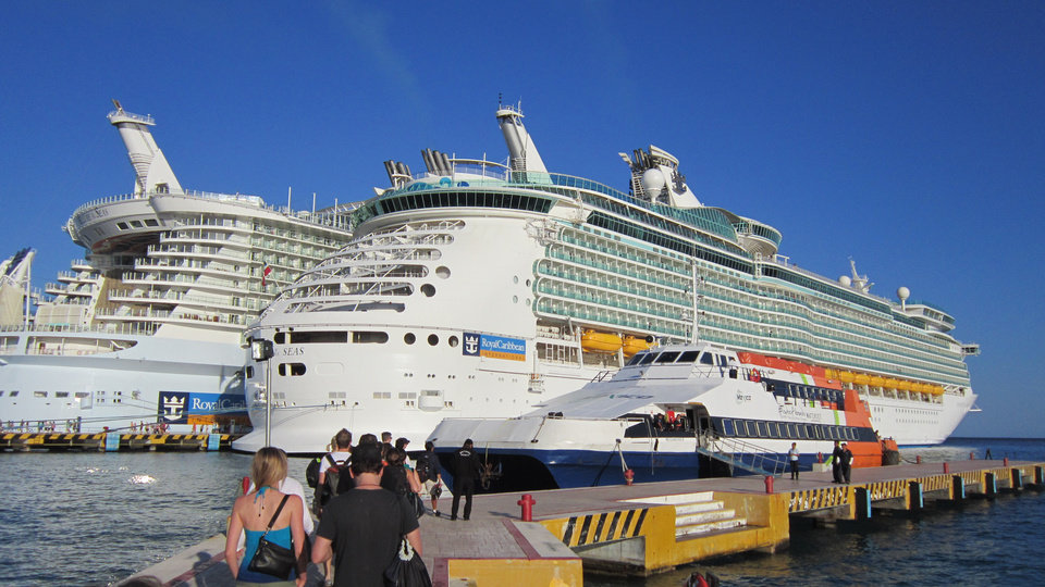 Photo - Navigator of the Seas is docked with Allure of the Seas, on the left, and Cozumel Ferry to the right.   PHOTOS BY RICHARD DARNELL, FOR THE OKLAHOMAN    - Richard Darnell