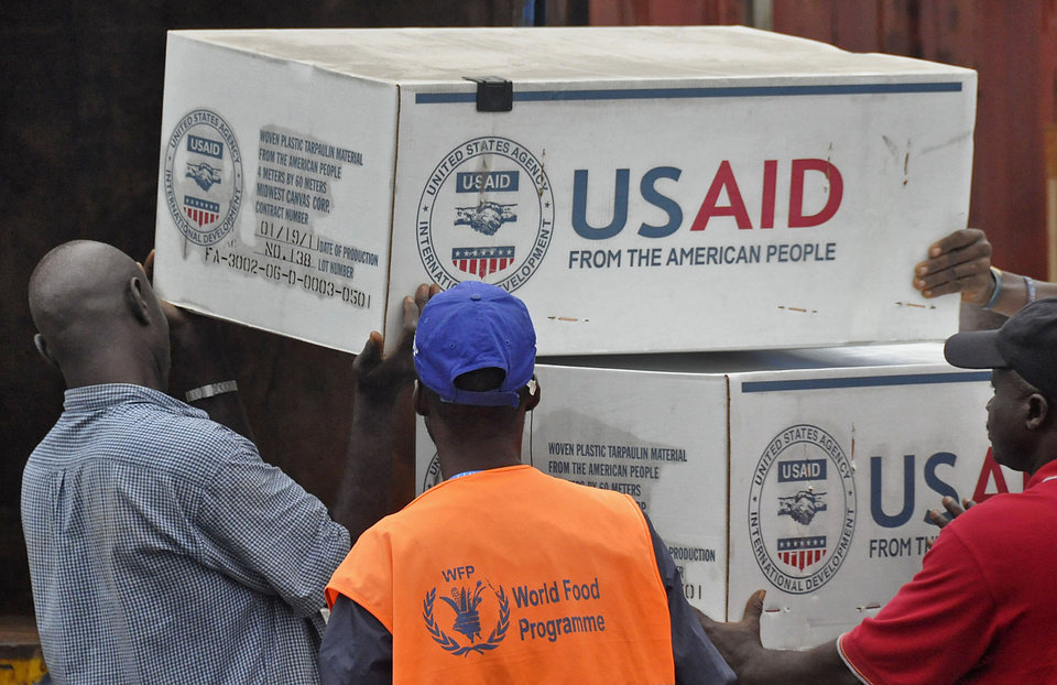 Photo - American Aid goods are loaded onto a truck after it arrived by airplane, to be used in the fight against the Ebola virus spreading in the city of Monrovia, Liberia, Sunday, Aug. 24, 2014. Two alarming new cases of Ebola have emerged in Nigeria, widening the circle of people sickened beyond the immediate group of caregivers who treated a dying airline passenger in one of Africa's largest cities. The outbreak also continues to spread elsewhere in West Africa, with 142 more cases recorded, bringing the new total to 2,615 with 1,427 deaths, the World Health Organization said Friday. (AP Photo/Abbas Dulleh)