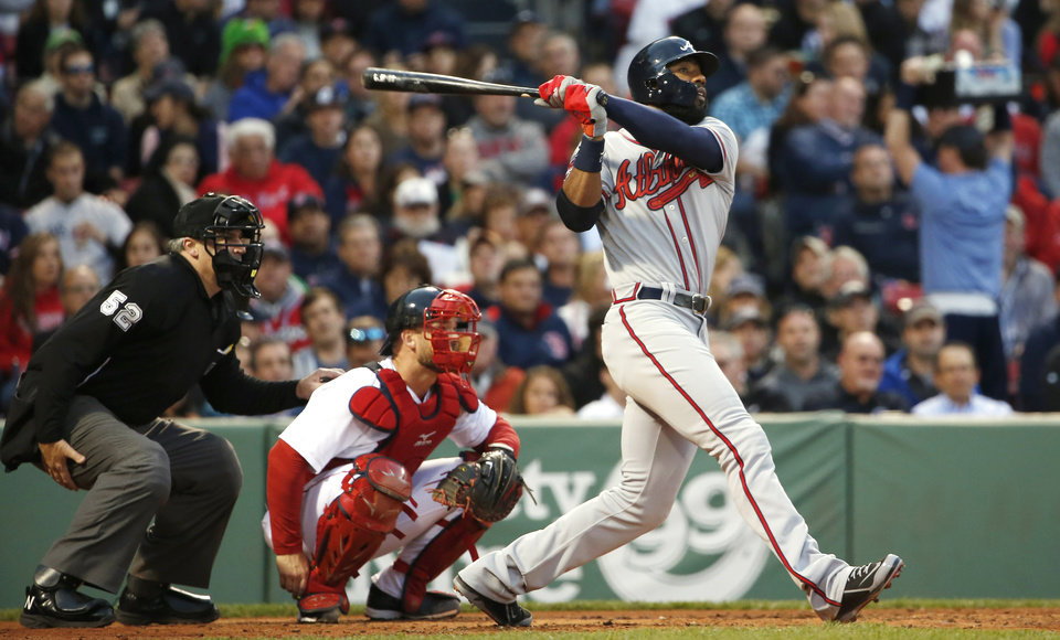 Photo - Atlanta Braves' Jason Heyward, right, follows through on his solo home run as Boston Red Sox catcher David Ross looks on during the third inning of a baseball game at Fenway Park, Thursday, May 29, 2014, in Boston. (AP Photo/Winslow Townson)