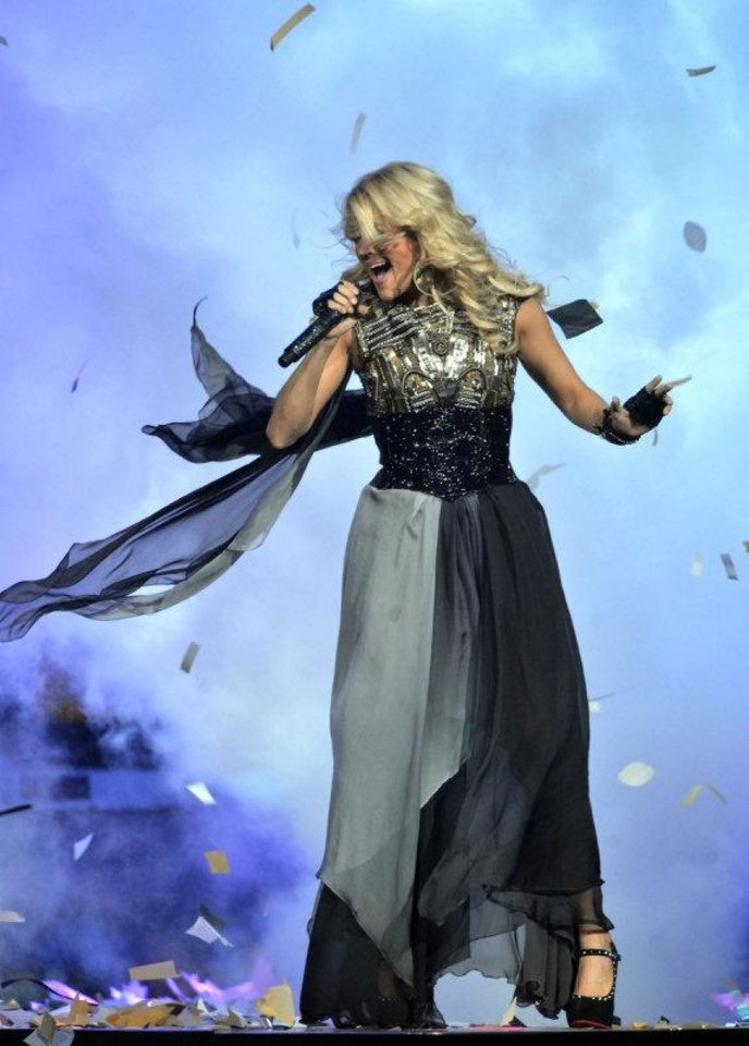 Photo - Carrie Underwood performs at Bridgestone Arena in Nashville, Tenn., during her