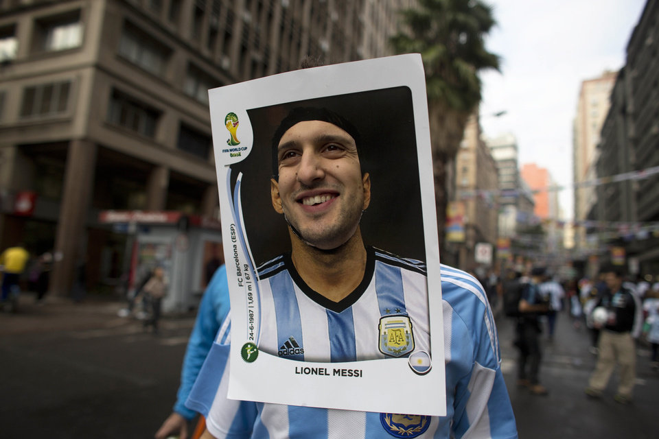 Photo - An Argentina soccer fan wears a cutout image of Argentine soccer star Lionel Messi as he heads to the stadium to see the World Cup match between Argentina and Nigeria in Porto Alegre, Brazil, Wednesday, June 25, 2014.  (AP Photo/Dario Lopez-Mills)
