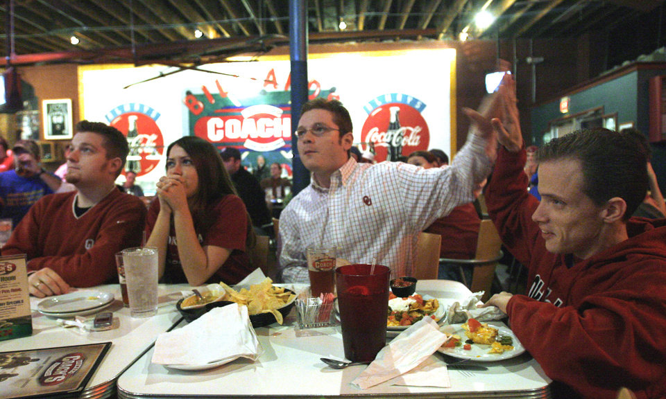 Chase Ervin, left, Kara Craig, Tory Ervin and Robbie Yarborough, right, react as they watched The University of Oklahoma (OU) play Boise State at Coach's restaurant on Main Street in Norman, Okla., on Monday, January 1, 2007. By Michael Downes, The Oklahoman
