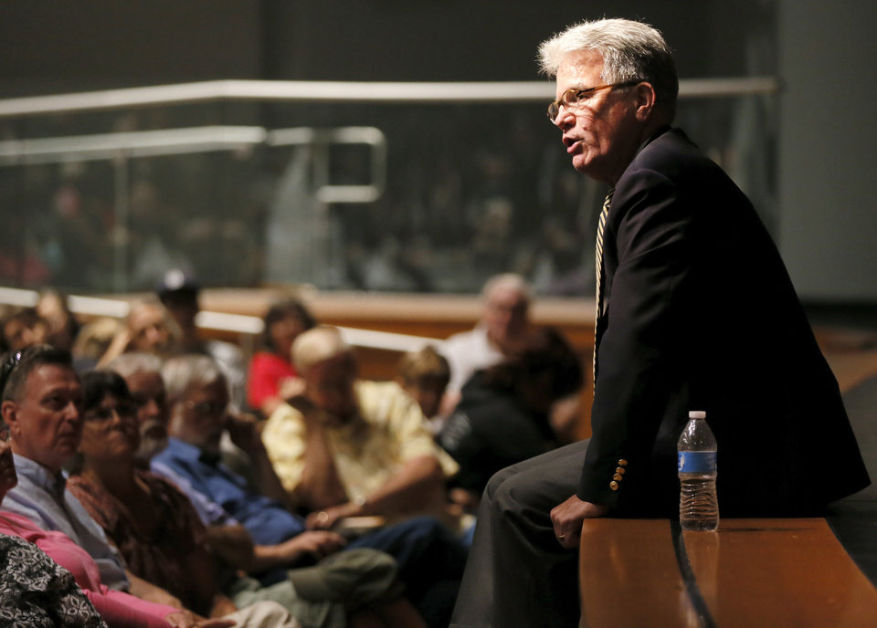Photo - Sen. Tom Coburn speaks during a town hall meeting at Oklahoma City Community College's Visual and Performing Arts Center in Oklahoma City, Monday, Aug. 4, 2014. Photo by Nate Billings, The Oklahoman